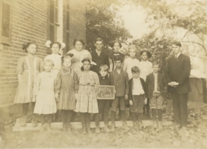 Poplar Creek Students 1911; Teacher is Frank George.