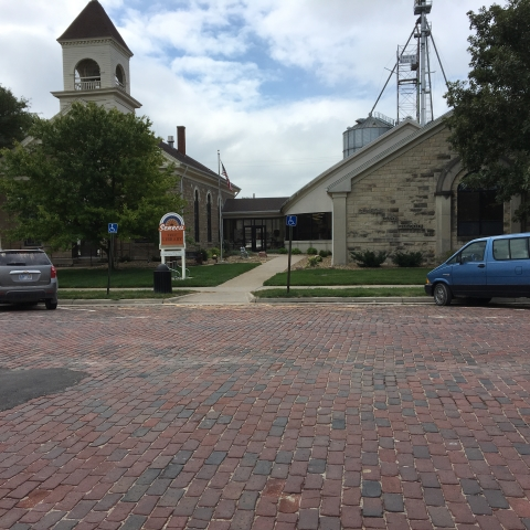 The Seneca Free Library Original Universalist Church on left Seneca, KS