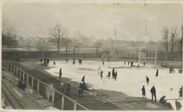 During the Winter, due to Jordan Field's poor location, it often flooded which allowed for it to be turned into a place where ice skating took place, photo was approximately taken around 1915-1916.