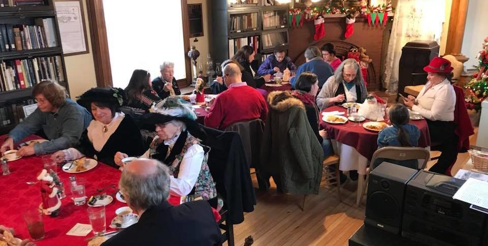 Historical society members enjoy a holiday get together in the Buck House.