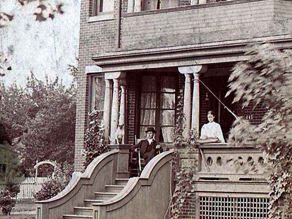 A.W. and Hattie Buck on the front porch of their impressive home.