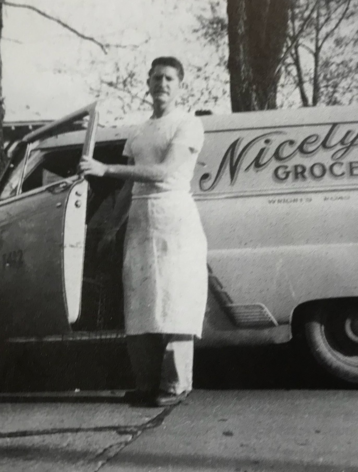"Nicely Butcher Otha ""Junoir"" Regan stands beside delivery truck"