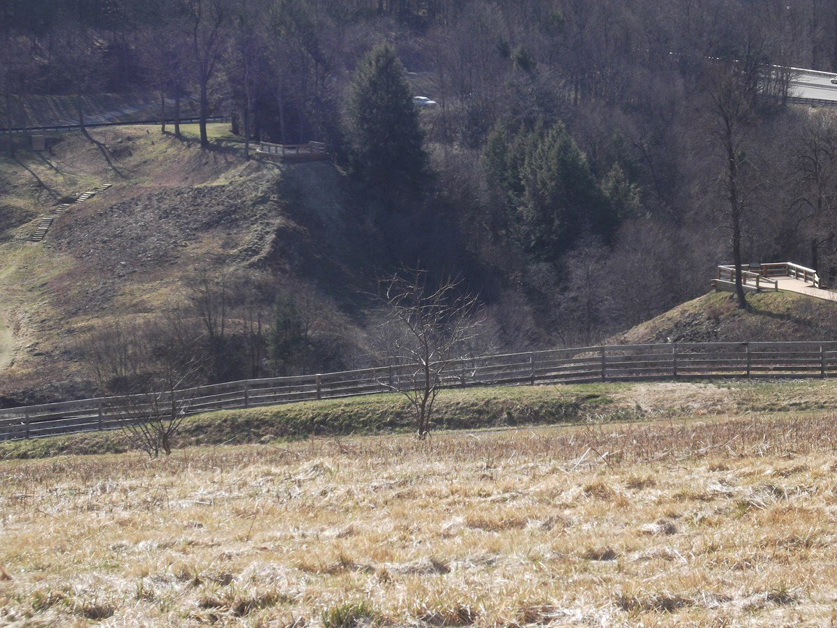 A view of the remnants of the South Fork Dam with the missing 270-foot section that was removed by the rushing water.