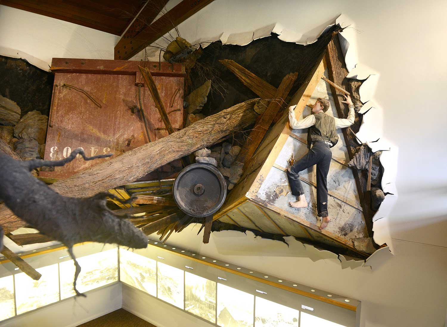 A diorama within the Visitor's Center museum depicting a man clinging to his home as it's swept away.  This display also includes an audio recording of the man's tale.