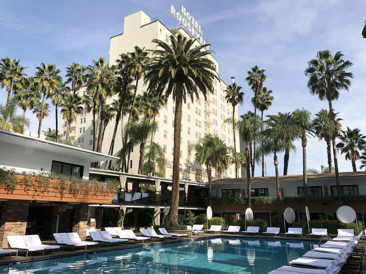 The pool at the Hollywood Roosevelt with the historic sign seen in the distance