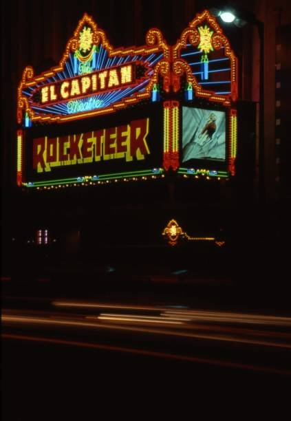 "The El Capitan Theatre advertising the premiere of Disney's ""The Rocketeer"" after the theatre re-opened after a two year renovation in June 1991"