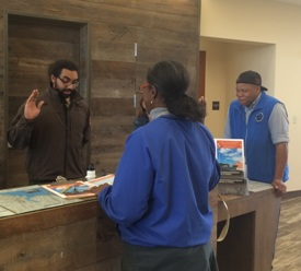 A visitor taking the Junior Ranger pledge with a park ranger at the Harriet Tubman Underground Railroad Visitor Center.
