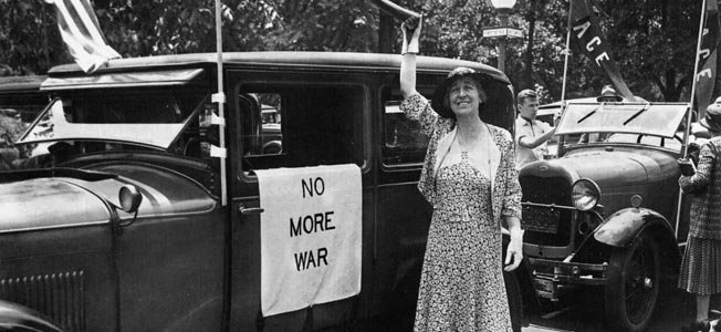 Jeannette Rankin advocating for peace and against the U.S. become involved in war.