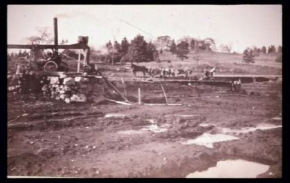 Construction of Brooks Pond 1884 (image from Medford-Brooks Estate Land Trust Archives)