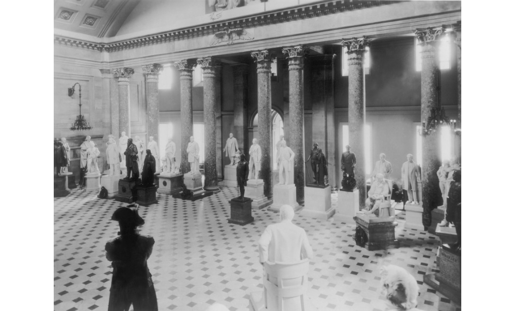 The National Statuary Hall in 1932 from the Prints and Photographs Division of the Library of Congress. Since the hall was crowded at this time, some statues were placed in other locations in the Capitol.