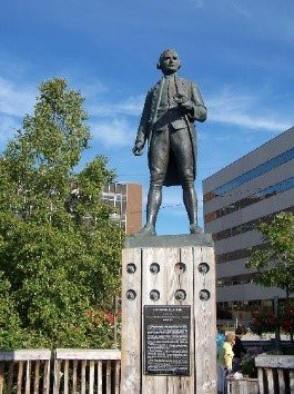 This is the front of Captain James Cook's statue located in Anchorage, Alaska. He stands tall and looks onto the sea, as he did on his ships. The visitors of the statue must look up to the famous man, which shows signs of intelligence and confidence.
