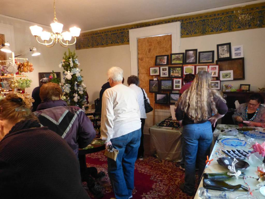 A fundraising event inside the house. Notice the stencil work on the wall.