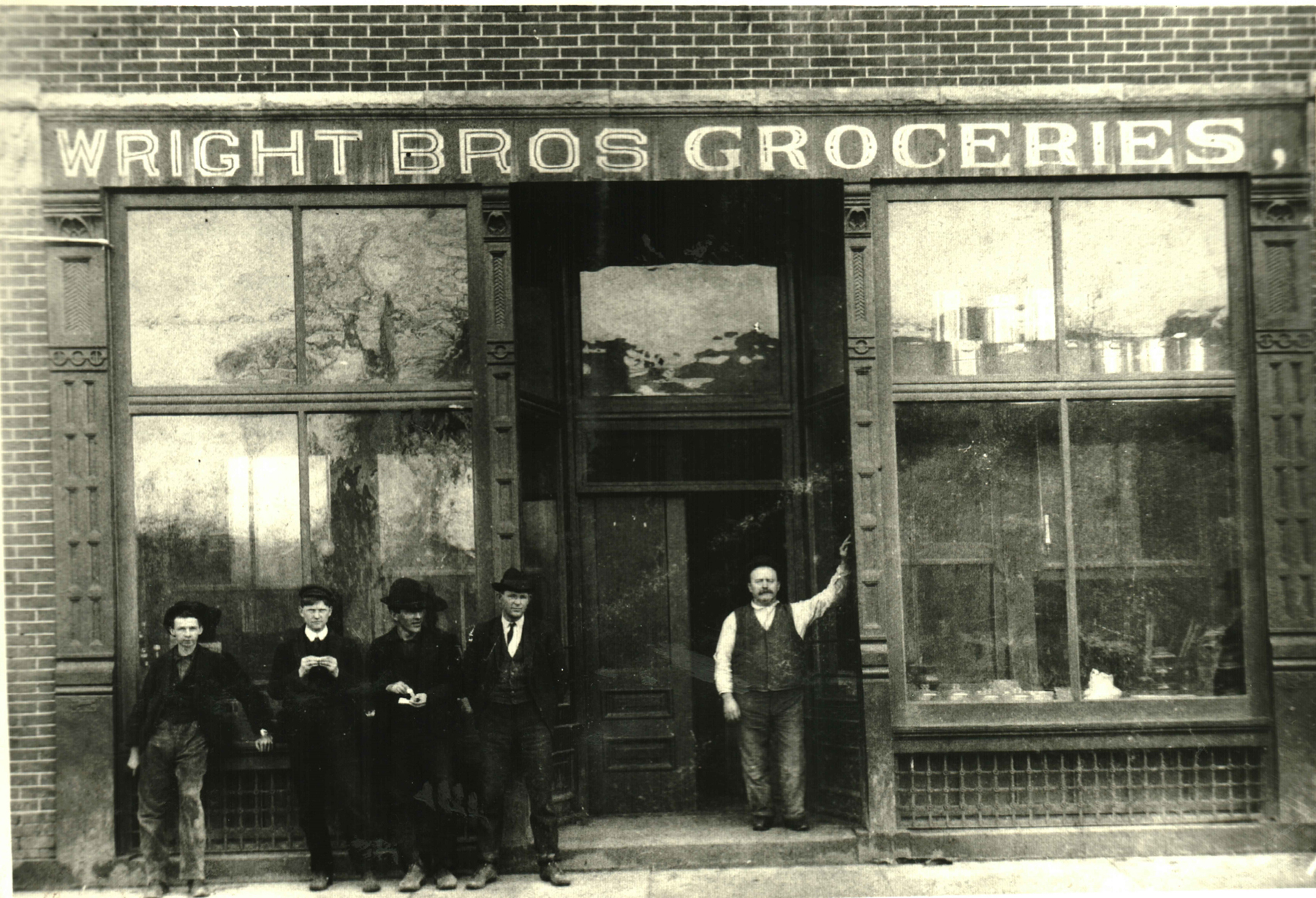 Wright Brothers storefront. In addition to groceries, the business sold dry goods, clothing, paint, wallpaper, and other products.