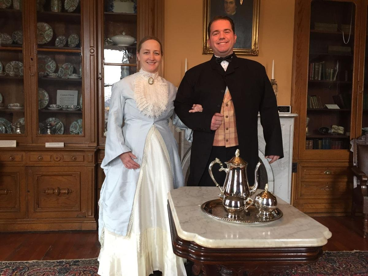 Period actors, dressed as Silas and Clarissa Clark, greet visitors to Victorian Tea in April of 2018.