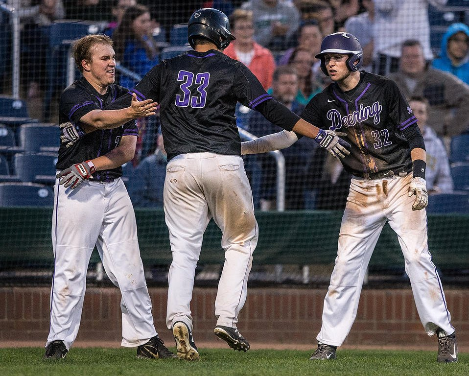 Deering High School teammates celebrating 