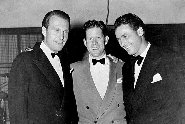 The two founders of the Racquet Club, actors Ralph Bellamy (right) and Charlie Farrell (left), with singer, actor, and radio host Rudy Vallee celebrating the opening of the Club