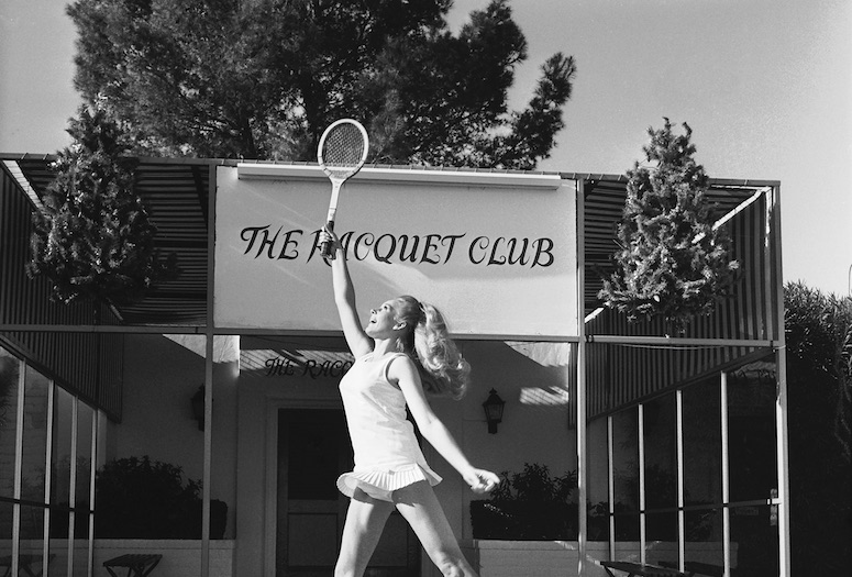 A model posing in front of the Racquet Club towards the end the club's more glamorous days, 1967