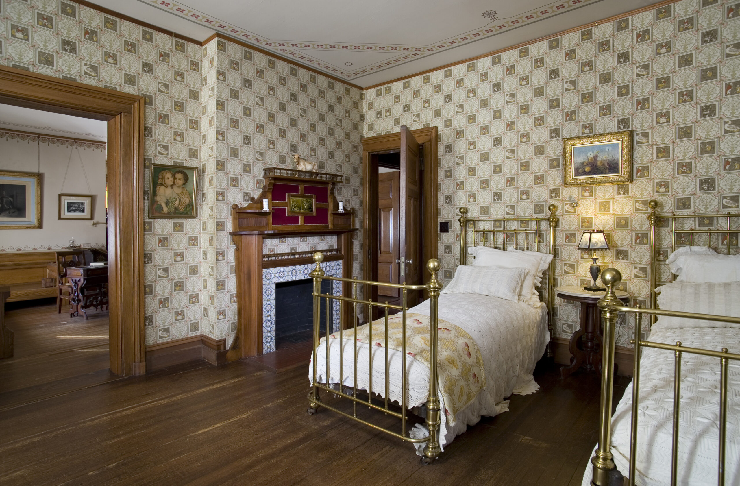 "The Nursery: Served as Clara and Jean's room, the wallpaper illustrating the nursery rhyme ""Ye Frog He Would A-Wooing Go"""