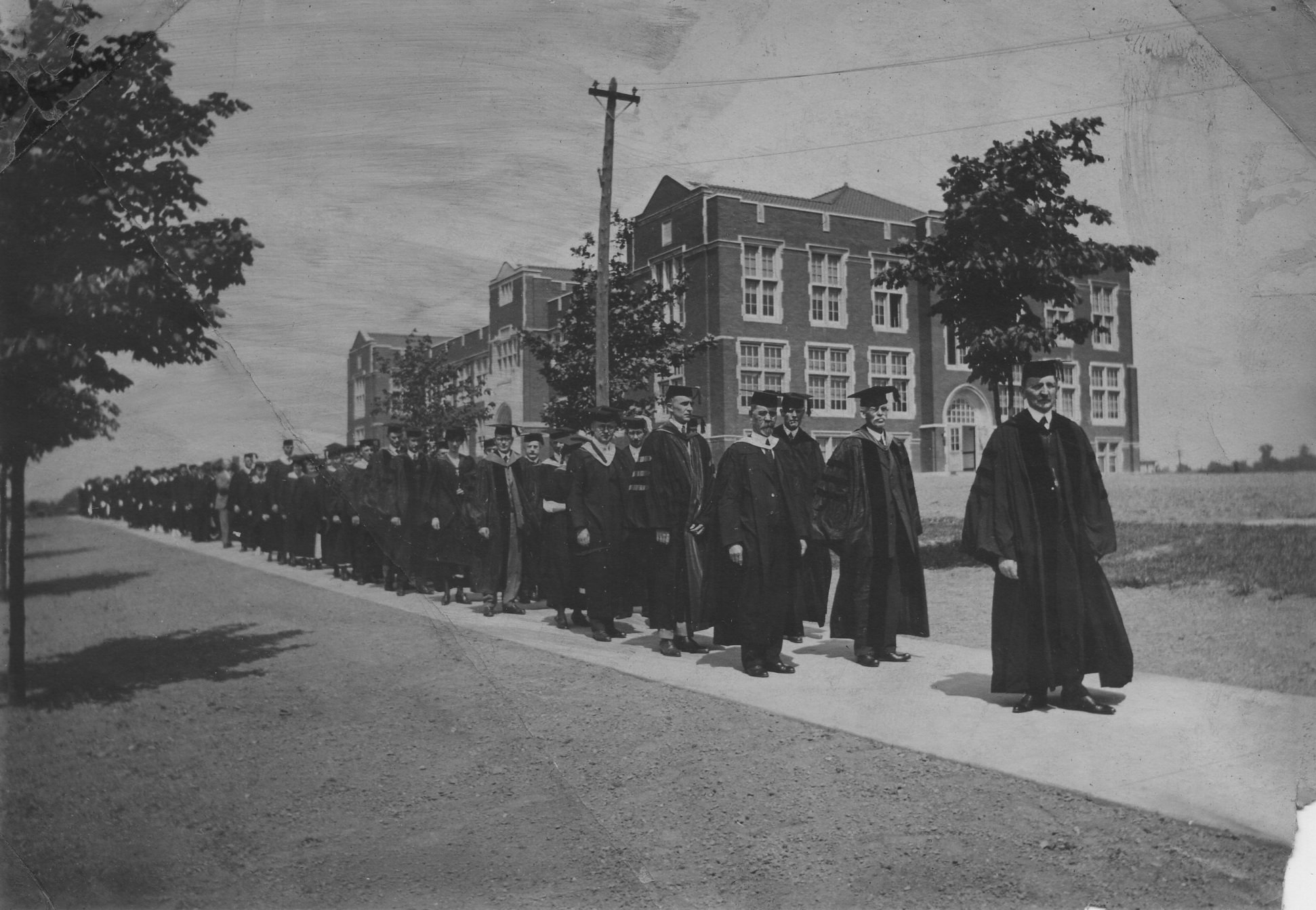 John Knox Montgomery walking in front of Montgomery Hall