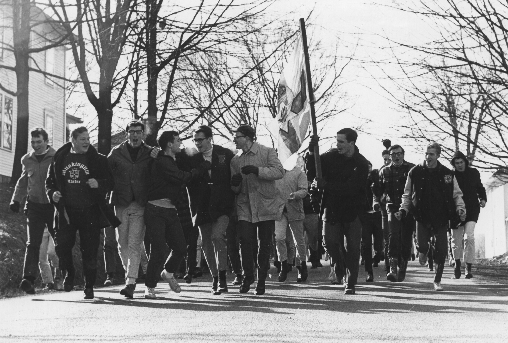 Ulster Men running while carrying the flag of Ulster.