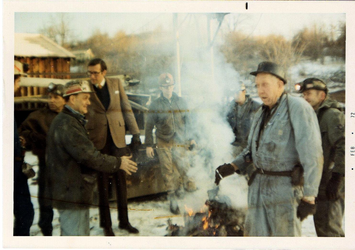 John D. Rockefeller, IV campaigning for governor at Siltix Mine, Mt. Hope, WV 1972 photo taken by Shirley Love. Those in the photo are Adrian Keeney, Governor Jay Rockefeller (left) and Junior Coleman, far right.