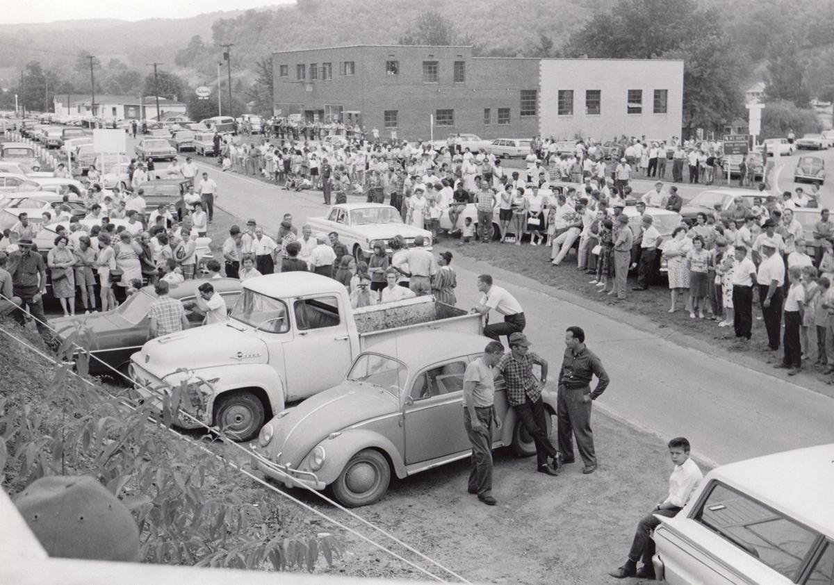 A large crowd gathers after the news of the disaster from an underground explosion at New River Company's Siltix Mine on July 23, 1966. The photo was taken at a point near the mine's entry, which is just a few feet from U.S. 21 and within Mount Hope