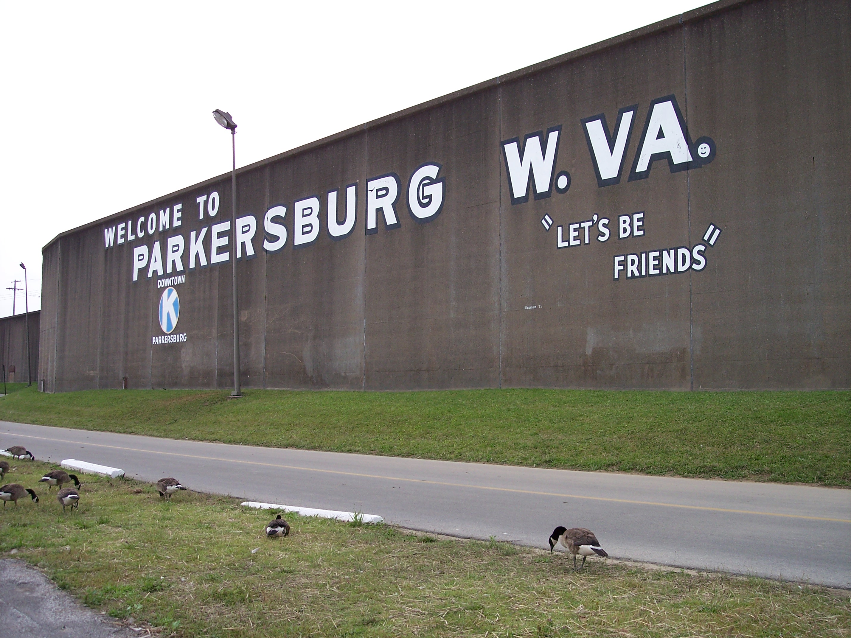 A present-day view of the floodwall with its welcoming mural. Nearby is The Point, where a park allows visitors a recreational space at the confluence of the Little Kanawha and Ohio Rivers.