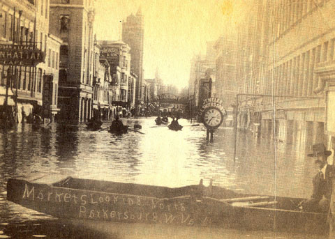 The 1913 flood still holds the record crest stage at 58.9 feet. This photograph from downtown Parkersburg illustrates its severity. Cities up and down the Ohio Valley were badly affected. Courtesy of HurHerald.com.