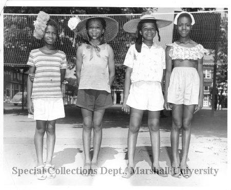 Winners of Hat Show contest at Barnett School playground,  ca.1951
