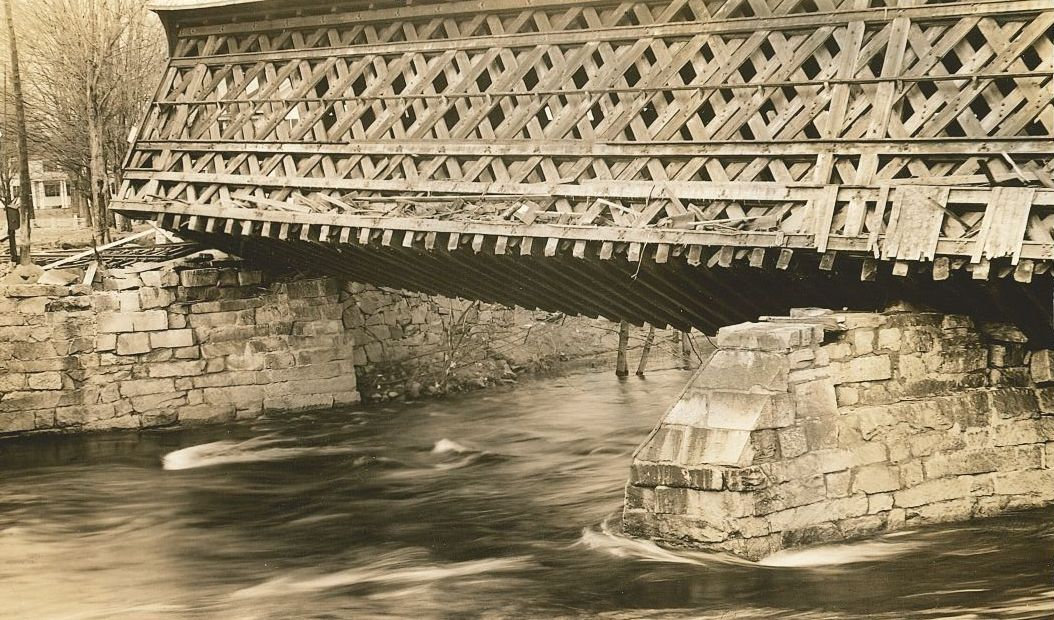 Image of the covered railroad bridge in Contoocook after it was tipped during the 1938 hurricane.