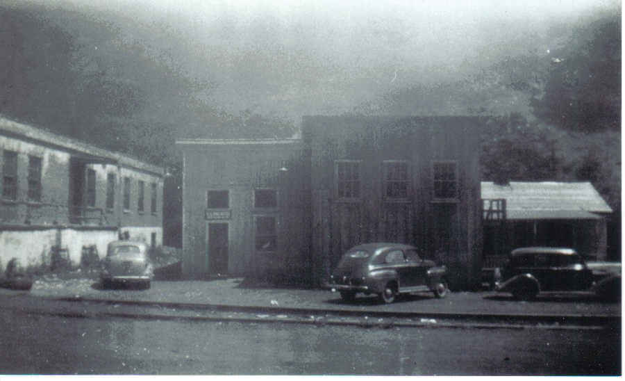The building on the left was apart of the Glen Alum Coal Company Store. Moving left to right, the smaller building in the middle of the picture was the Post Office, and the larger building in the middle of the picture was the Company Movie Theater.