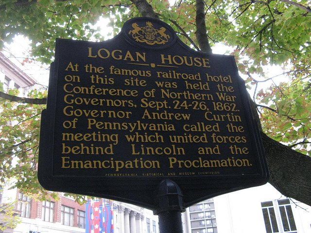 The Logan House marker.  Unfortunately, the marker is between a parking garage wall and a USPS chain link fence.