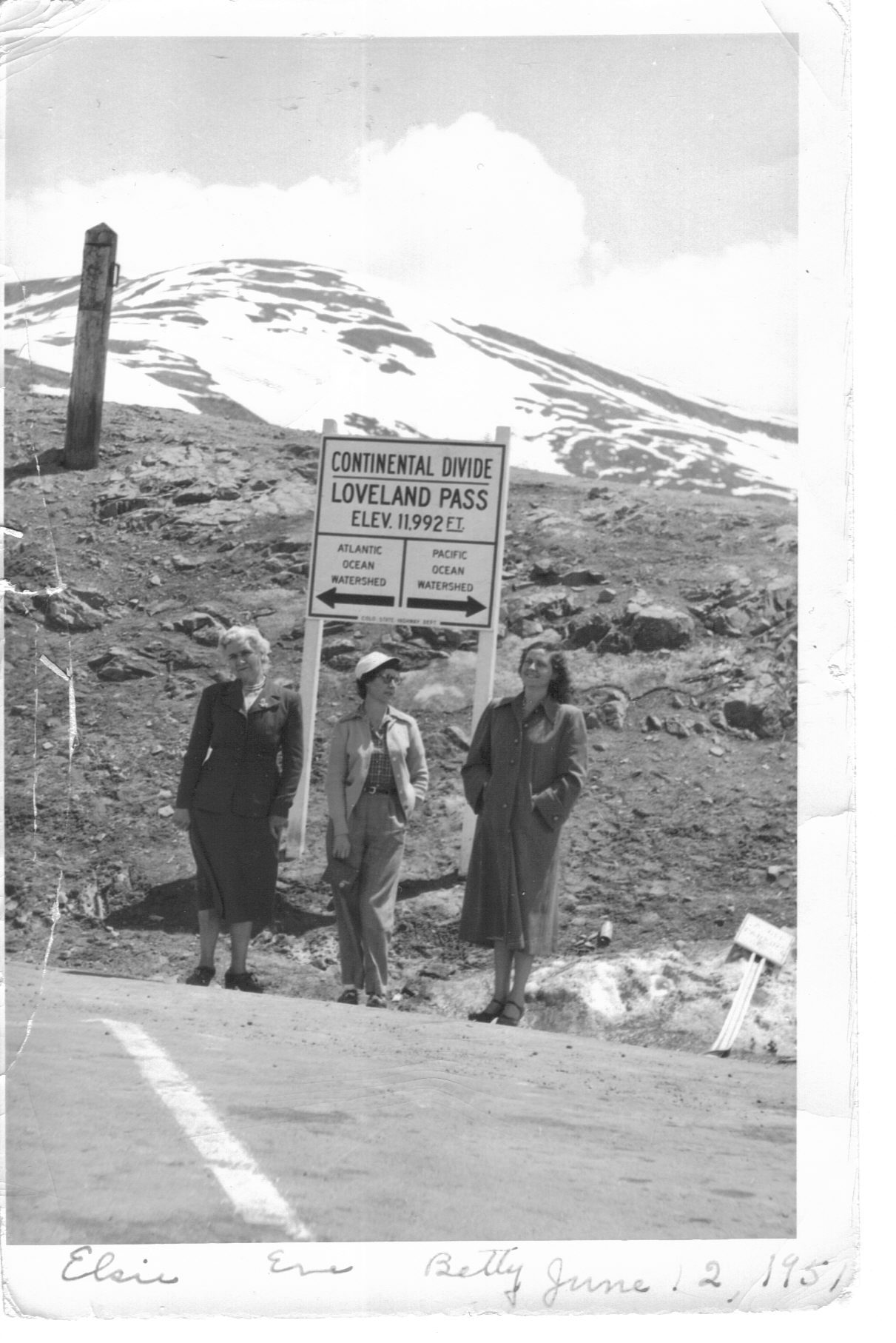 Three Frisco women- Elsie, Eve, and Betty- stand on the Continental Divide at Loveland Pass. Circa 1951.