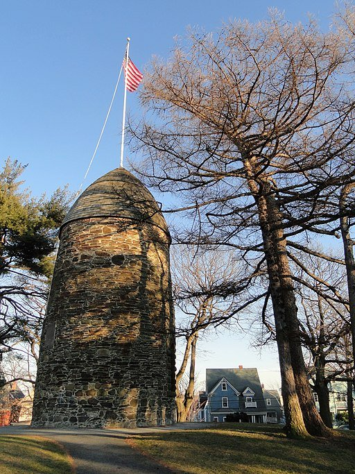 The Old Powder House as it appears today in Nathan Tufts Park, with roof repairs done after a fire in 1998, courtesy Wikimedia user Daderot.