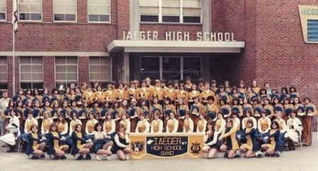 Student members of the band pose outside of the school in 1979