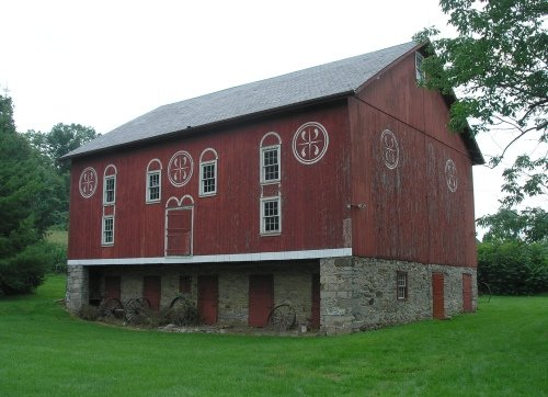 This late 19th century barn now houses vintage farm equipment, carriages and sleighs.