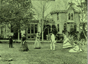 Guests play croquet on the lawn of the Hooker house