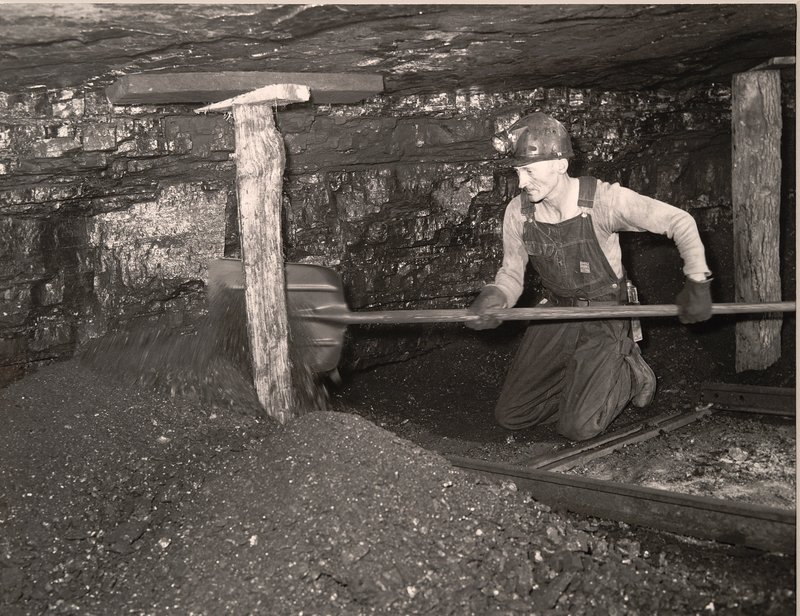 A Miner Shoveling Coal