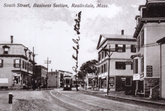 Previously known as the business section of South St, this area is now thought of as Roslindale Village. The street car in the center connected Forest Hills Station with West Roxbury. Today, the Roslindale Village Commuter Rail is in the distance.