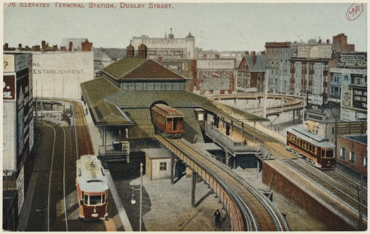 """Postcard of Dudley Street Station.  Note all of the signs on the righthand side indicating different stores.  Exact date and artist are unknown but in the """"Arts in Transit"""" collection at the Boston Public Library.  Courtesy Creative Commons"""