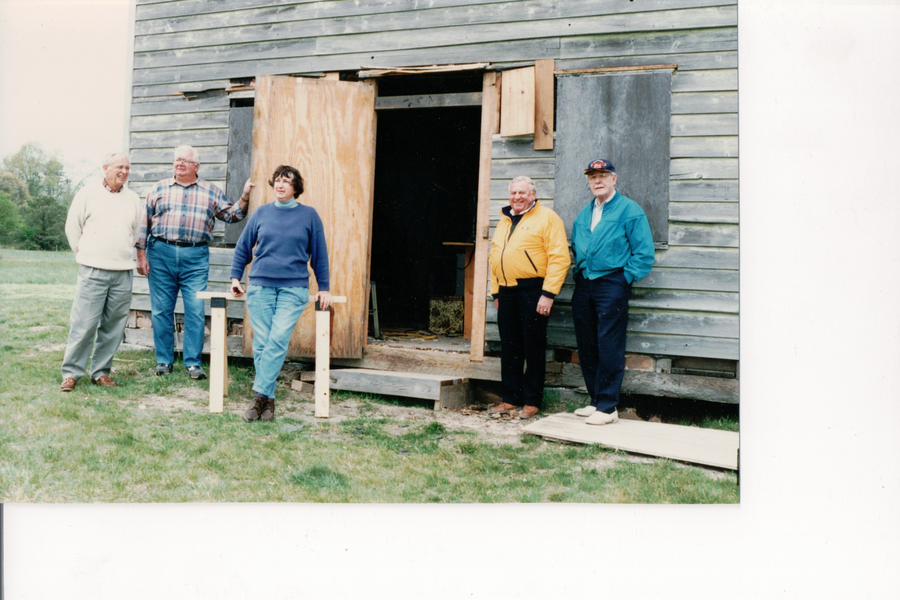 The Gandy House in its early stages of restoration. @1980 The members of the restoration crew are from left to right:James Siegrist, Paul Kuhnle, Sonia Forry, and Reynolds Schmidt.