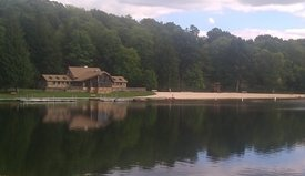View of Herrington Manor State Park with the Visitor Center and the lake shown, both of which were built by the Civilian Conservation Corps; photo courtesy of Maryland Department of Natural Resources