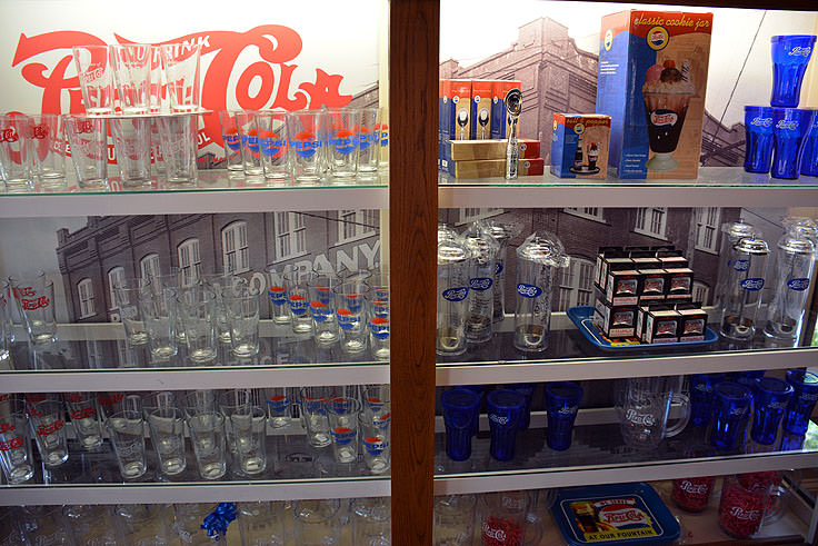 This is a variety of soda bottles and Pepsi memorabilia in Bradham's Pharmacy.