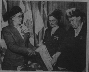 "Mrs. E. M. Harding, left, president of the London Chapter, Silver Cross Women of Canada, holds the ""Book of Remembrance"" for members, Mrs. Florence Smith, Byron, and Mrs. Peter Fay, right, of London. (Taken from London Free Press caption)"