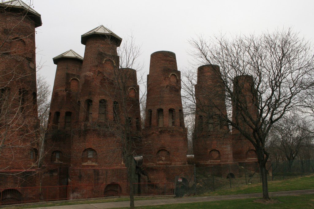 "The Coplay cement kilns rise like spires from Saylor Park.  The ""caps"" were added in an attempt to protect them from the elements."