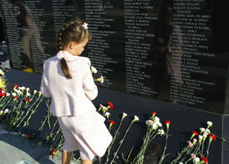 The memorial incorporates a granite wall that includes the names of each of the victims.