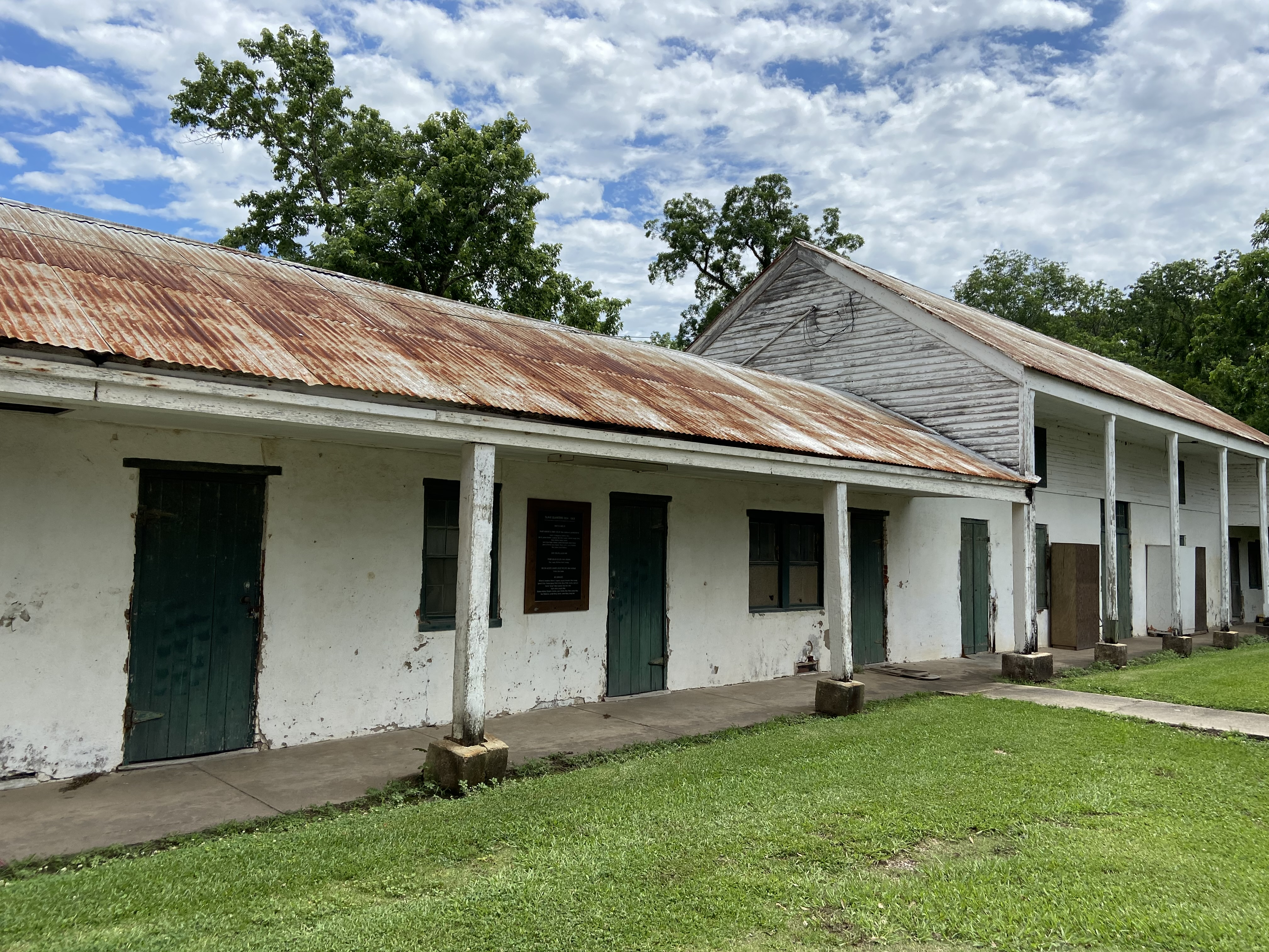In 1834, the first brick dwellings were constructed for the enslaved persons at the Academy. These quarters are still in existence and now bear a plaque listing the known names of the families and individuals who resided there.