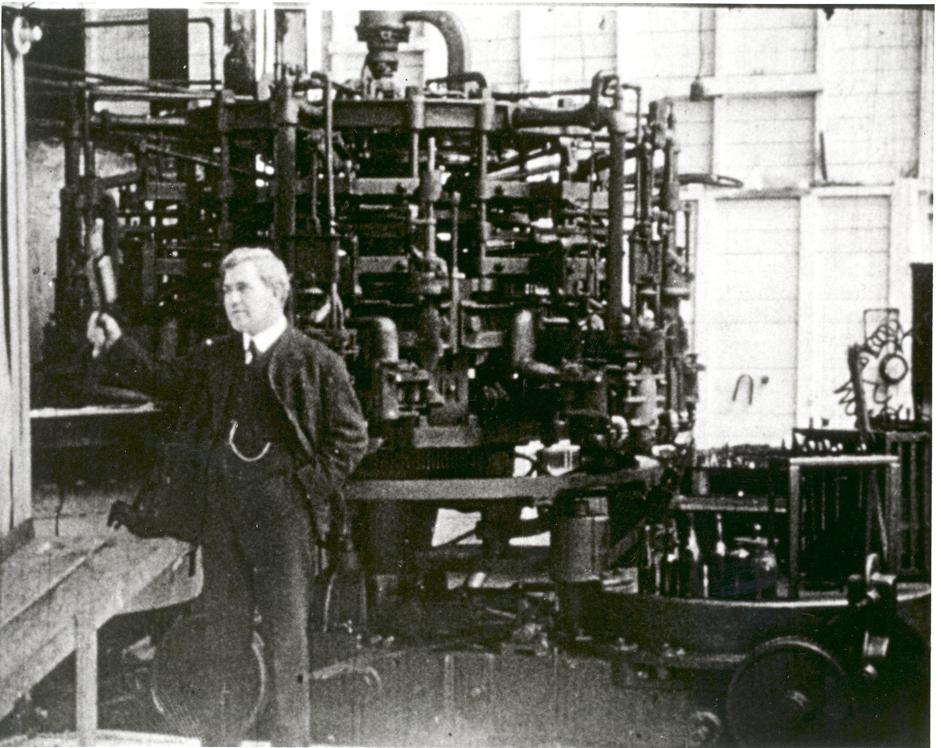 Photo of Michael Owens with his bottle-making machine c. 1910. Photo from utoledo.edu