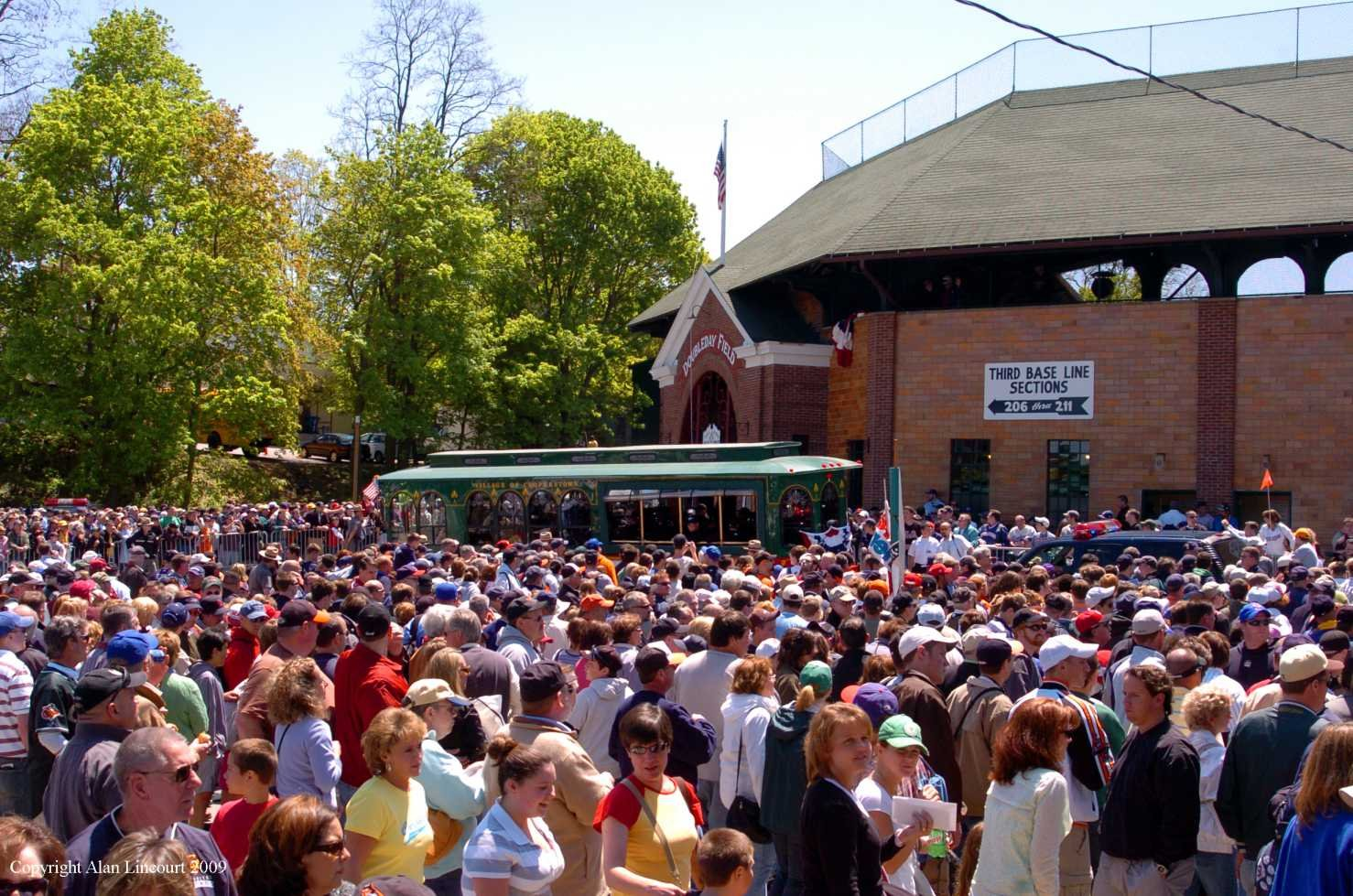 Photo by Alan Lincourt. A crowd packs the outside area and parking lot to Doubleday Field.
