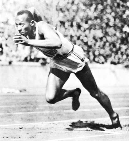 1. Jesse as he competes in one of his events for the United States. (Encyclopaedia Britannica).